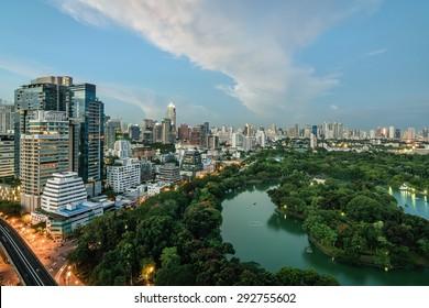 Wonderful evening period cityscape at Lumphini Park, Bangkok, Thailand. Lumphini Park (or Lumpini Park) is a park in Bangkok, Thailand.
