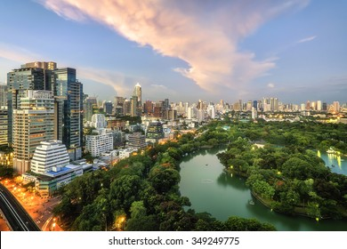 Wonderful evening period cityscape at Lumphini Park, Bangkok, Thailand. Lumphini Park (or Lumpini Park) is a park in Bangkok, Thailand. The cloud is orange.