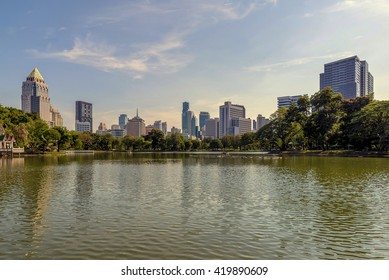Wonderful evening period cityscape at Lumphini Park, Bangkok, Thailand. Lumphini (Lumpini) Park is a park in Bangkok, Thailand.