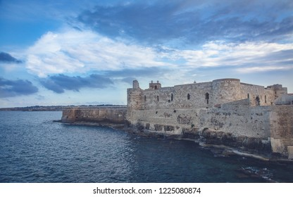 Wonderful evening view of famous Castello Maniace in Siracusa, Italy