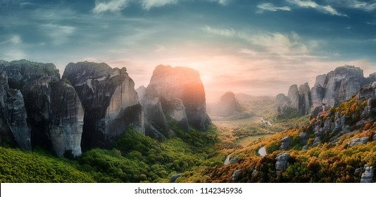 Wonderful Fairytale mountain valley under sunlit at Greece. amazing  Panoramic view.  incredible nature landscape. Meteora monasteries, Greece Kalambaka. Creative image. Awesome sunny View at sunset.