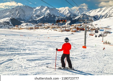 Wonderful famous ski resort with skiers in high mountains, Alpe d Huez, France, Europe