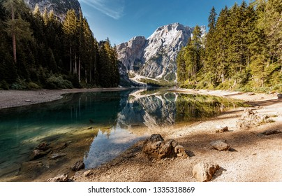 Wonderful foggy morning at Braies lake in Dolomites alps. Amazing nature landscape. lake and Seekofel mount on background in fog, during sunrise. Lago di Braies, Pragser wildsee