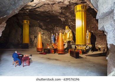 Wonderful Gold Dao Statue in meditation inside temple of China cave monastery. Wenzhou. Zhejiang province. China
