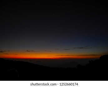 The wonderful of horizon or skyline just before sunrise at Doi Inthanon viewpoint, Chiang Mai, Thailand.