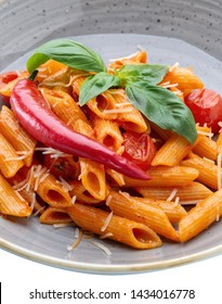 A wonderful Italian pasta dish in tomato with spinach and paprika.