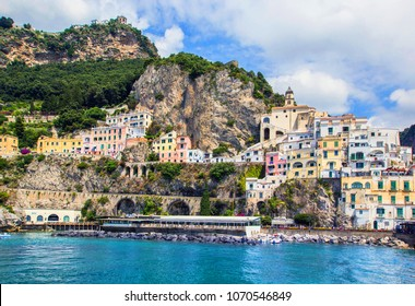 Wonderful Italy. Small haven of Amalfi village with turquoise sea and colorful houses on slopes of Amalfi Coast with Gulf of Salerno, Campania, Italy.