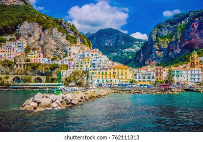 Wonderful Italy. The small haven of Amalfi village with a turquoise sea and colorful houses on the slopes of the coast