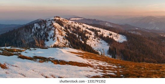 The wonderful landscape of the Carpathians in the early spring, the Beskydy region. beautiful view of the Carpathian mountains (Beskydy region) at sunset is partly covered with snow.