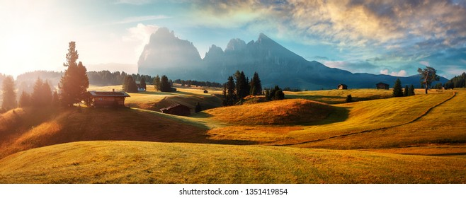 Wonderful Landscape with colorful sky. Seiser Alm (Alpe di Siusi) with Langkofel mountain at sunrise, Italy. Dolomites, Trentino Alto Adige, South Tyrol, Italy, Europe. Popular travel destination