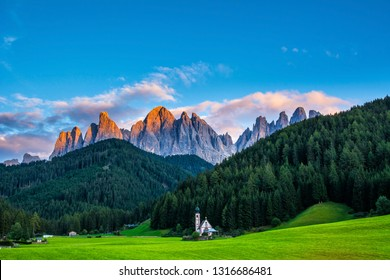 Wonderful landscape of Dolomite Alps during sunset. St Johann Church, Santa Maddalena, Val Di Funes, Dolomites, Italy.