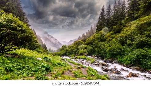 Wonderful landscape with mountain river and overcast sky. waterfall in the mountains.Balea waterfall in Fagaras mountains, Sibiu,Transylvania, Romania. near Transfagarasan road. Hiking, travel Concept