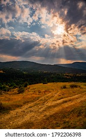 Wonderful landscape in mountains at sunset. Dramatic sky with colorful clouds over the hills. Beautiful natural landscape in the summer time.
