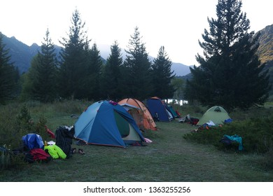 Wonderful landscape overlooking the tents of tourists located on the banks of the Katun River and the beautiful Altai Mountains. Atmospheric beauty of wild places, Altai Republic, Russia.