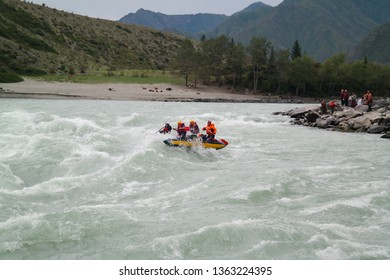 Wonderful landscape with a view of the Ilgumensky rapid and the extreme sportsmen on catamarans. Turquoise river Katun, Altai Republic, Russia.