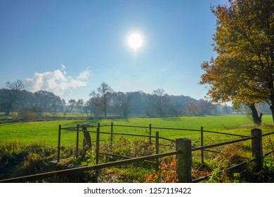 Wonderful landscape view with an rusty fence in front