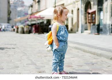 A wonderful little girl walking along the street