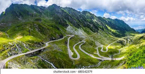 wonderful mountain scenery. mountain road with perfect blue sky. creative image. Transfagarasan highway, the most beautiful road in Europe, Romania (Transfagarash), Ridge Fagaras