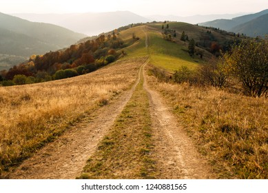 Wonderful mountain under the sunlight. caskade mountains hills off the road at sunset. impressively beautiful background of nature. Traveling is a way of life. The idea of an adventure lifestyle.
