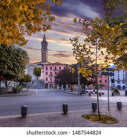 Wonderful natural cityscape. Scenic landscapes of italy. Colorful summer sunrise on the Lecco town on lake Como with colorful sky during sunset. Popular Travel destinations. Creative image