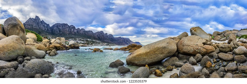 Wonderful nature of Camps Bay (Kampsbaai) - affluent suburb of Cape Town. Camps Bay bordered by spectacular Twelve Apostles Mountain and glittering Atlantic Ocean. Camps Bay, South Africa.