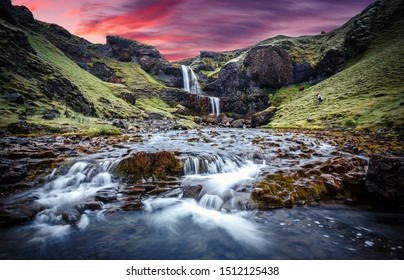 Wonderful nature of Iceland. fresh green grass and icelandic moss near river with waterfall. Typical Icelandic scenery during sunset.  Picture of wild area. Dramatic Scene with colorful sky