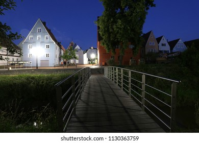 wonderful night scene, small bridge over river on background multicolor Bavarian buildings , Donauworth - old town of romantic road of Germany, Schwaben (Swabia), Bavaria, Europe, wallpaper townscape