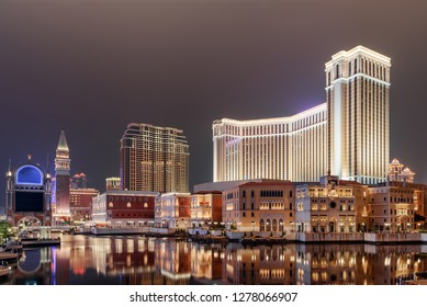 Wonderful night view of amazing buildings in Venetian Gothic style reflected in water in Cotai of Macau. Beautiful cityscape. Cotai is a new gambling and tourism area with casinos and shopping malls.