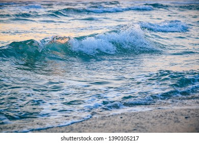 Wonderful ocean waves in sunset light