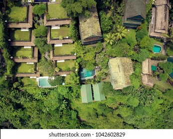 wonderful panorama of the roofs of cottages in a green oasis,the view from the top