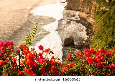 The wonderful panoramic scene the shore of the Indian Ocean on the sunset. South Bali, Indonesia. The view from the Uluwatu temple.