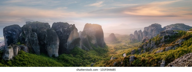 Wonderful Panoramic view of Meteora. Majestic sunny landscape with colorful sky over the fairytale mountain valley in Greece. Amazing spring scene of Famouse Kalabaka location, Greece, Europe.