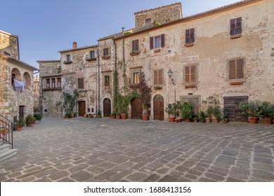 The wonderful Piazza del Castello square in the historic center of Montemerano, Grosseto, Tuscany, Italy