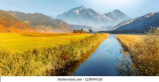 Wonderful picturesque Scene. Amazing Misty Morning. Beautiful nature Scenery. scenic view of Majestic Mountain Peak with river foreground, shoot in morning in Autumn season, Fantastic Alpine Landscape