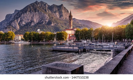 Wonderful picturesque Scene Colorful Sunset over the Lecco town on Como lake. Italy. Wonderful Autumn cityscape. Picturesque view of nature.   Best popular places for travel. Beauty of World. postcard