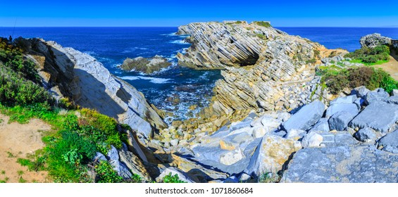 Wonderful romantic afternoon panoramic landscape. Coastline of island Baleal of the Atlantic ocean near Peniche. Famous geological sediments and tilts rocks. West coast of Portugal at sunny weather