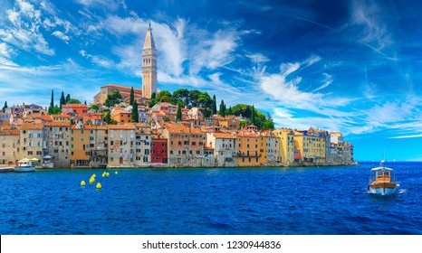 Wonderful romantic old town at Adriatic sea. Boats and yachts in harbor at magical summer. Rovinj. Istria. Croatia. Europe.