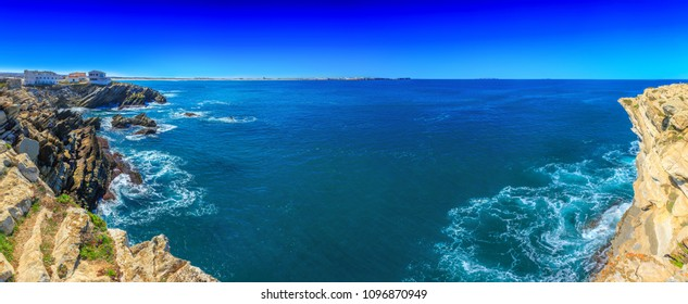 Wonderful romantic panoramic landscape. Coastline of island Baleal of the Atlantic ocean near Peniche. Famous geological sediments sandstone tilts rocks. West coast of Portugal at sunny weather.