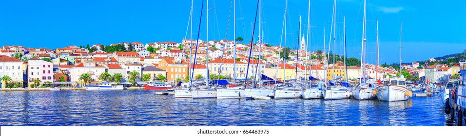 Wonderful romantic summer afternoon landscape panorama coastline Adriatic sea. Boats and yachts in harbor at clear transparent turquoise water. Mali Losinj on the island of Losinj. Croatia. Europe.