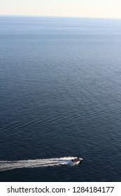 Wonderful seascape on the Crimean Black Sea coast. A beautiful yacht sails on the sea