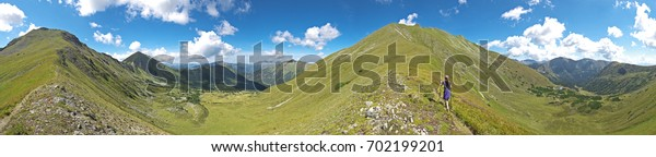 Wonderful secluded mountain path leads a climber to the summit of a high alpine mountain covered with green pastures. Picturesque panoramic landscape in Steiermark, Austria.
