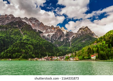 Wonderful small town by the lake in Dolomites, Italy