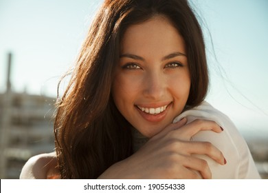 Wonderful smiling woman with a lovely look and bright make up. Natural young beauty. horizontal shot. outdoors