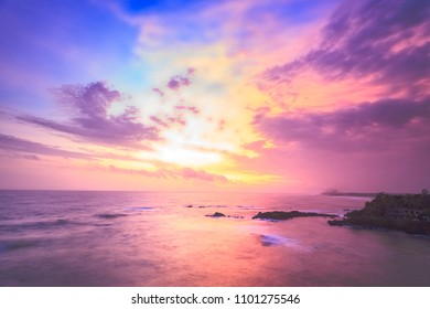 The wonderful splash of the bright colors in the evening sky. The sunset over the Indian ocean next to Galle, Sri Lanka. Stunning combination of the purple, violet, yellow and golden colors.