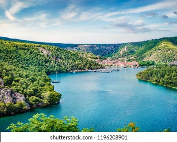 Wonderful spring cityscape of Skradin port. Aerial morning vire of Krka National Park, Prokljansko lake, Croatia, Europe. Beautiful world of Mediterranean countries. Traveling concept background.