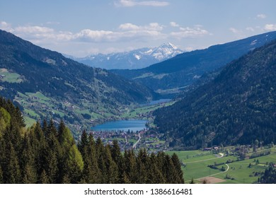 Wonderful Spring Mountain Landscape Panorama View Through Valley Gegental With Lake Brennsee And Lake Afritz And Mt. Mittagskogel In Background