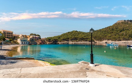 Wonderful summer seascape. Assos village in Kefalonia, Greece. Mediterranean architecture and turquoise Ionian sea.