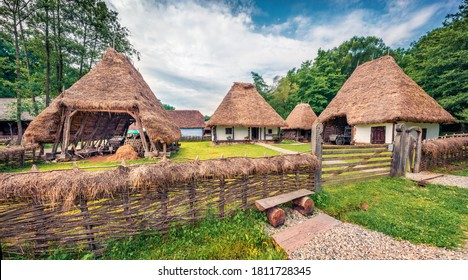 Wonderful summer view of traditional romanian peasant houses. Colorful rural scene of Transylvania, Romania, Europe. Traveling concept background.