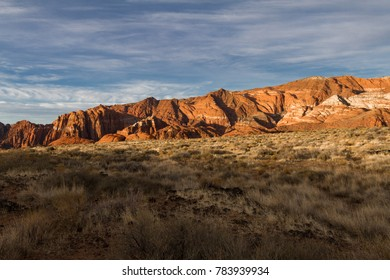Wonderful sun lit red Navajo sandstone mountains in Snow Canyon State Park in Utah.