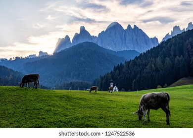 Wonderful Sunny Landscape of Dolomite Alps. St Johann Church, Santa Maddalena, Val Di Funes, Dolomites, Italy. Fairy valley in Dolomites mountains under sunlit. Amazing nature Background.